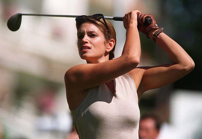 Cindy Crawford:                       Cindy strikes a Hogan-esque pose at a 1997 Omega-sponsored celebrity event in Switzerland.