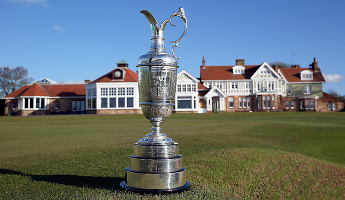 The claret jug sits in front of the 18th green and clubhouse, awaiting this year's champion.