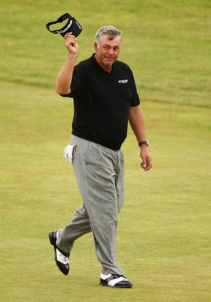 Last year's winner, Darren Clarke of Northern Ireland, has always been a snappy on-course dresser. With a commanding lead on the final day at Royal St. George's he went with a classic black-gray outfit, with dressy pleated pants and two-tone wingtip shoes – the sort of look that would go over well any time in the last 50 or 60 years.