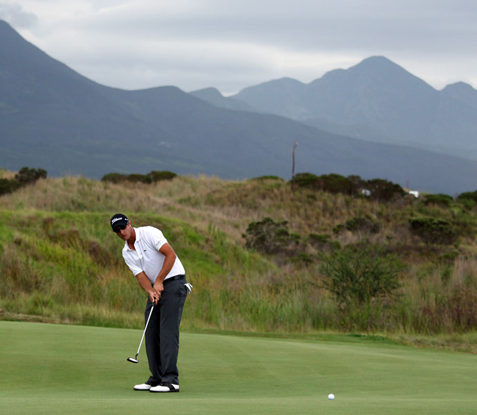 "Nicolas Colsaerts: ""Fancourt (Links). Why? First because I hold the course record there! It's linksy and on an unbelievable piece of land. It's a Gary Player design, and he did a wonderful job mixing some short holes and some very long ones. You don't really see one hole from another, which is great.""                                          Pictured: Colsaerts putts on the 17th green during the final round of the Volvo Golf Champions at The Links at Fancourt on January 22, 2012."