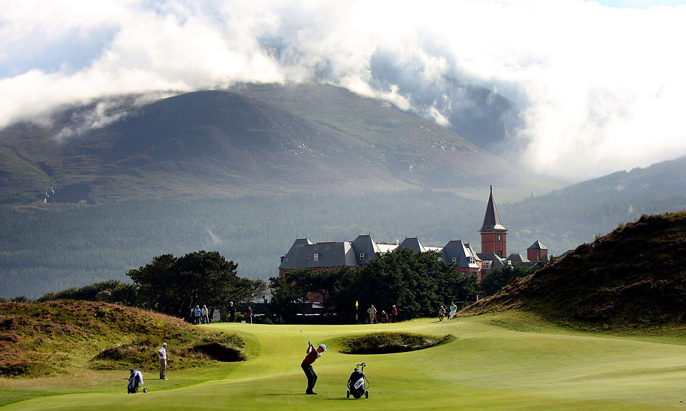 6. Royal County Down Golf Club -- No. 9: Par 4, 486 yards -- Newcastle, Northern Ireland                     Enjoy the sensational view from the tee, and then buckle up, because it's going to be a bumpy ride. Rising in the backdrop are the handsome white clubhouse, the red brick steeple of the Slieve Donard Hotel, the rooftops of Newcastle and the Mountains of Mourne. To the left, out of play but in full view, is the Irish Sea. The fearsome tee shot asks for a sure, trusting drive into a blind fairway eighty feet below that is framed by gorse-filled sandhills. The approach is only marginally easier. In heavy gusts, no hole on Earth better combines beauty and brawn.