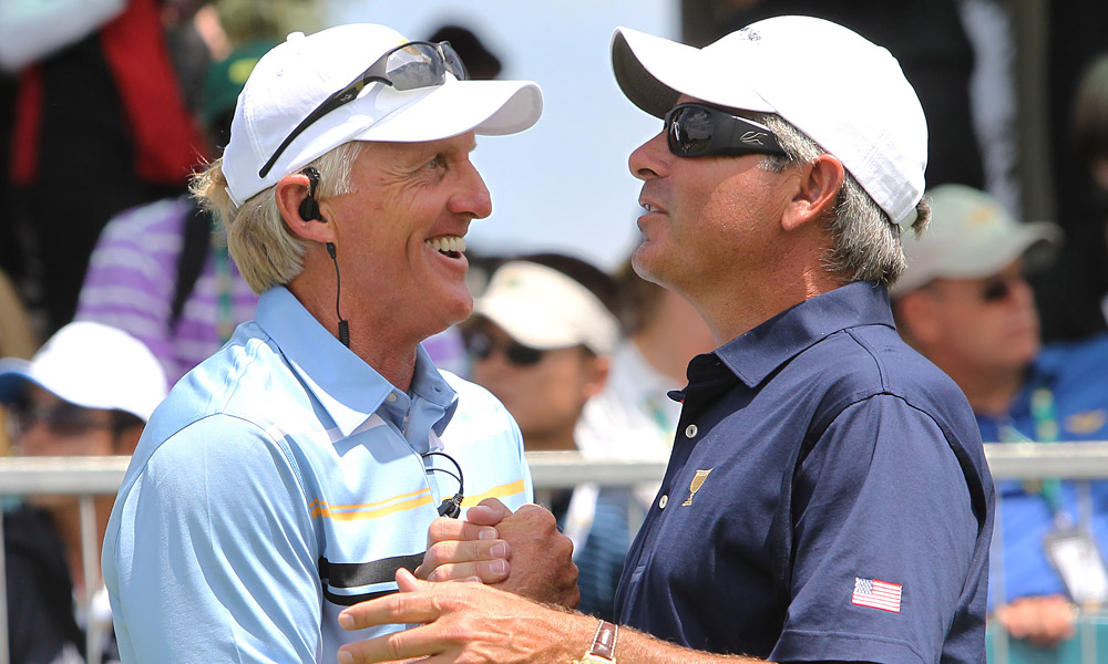 Captains Fred Couples and Greg Norman met on the first tee before the matches got underway.