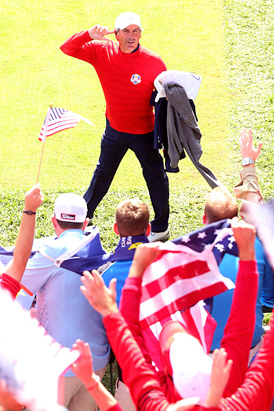 U.S. assistant captain Fred Couples tried to rile up the crowd on Sunday.