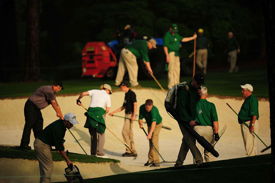 Members of Augusta National grounds crew were hard at work cleaning up after the storm.
