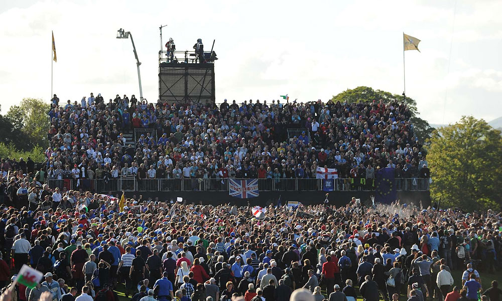 Fans at Celtic Manor charged the 17th green in celebration after Hunter Mahan conceded the final match to Graeme McDowell.