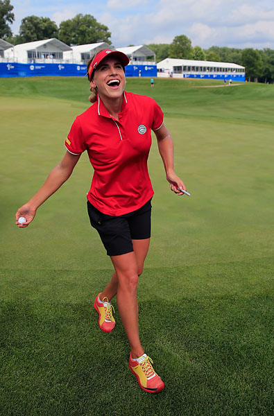 Belen Mozo of Spain throws her ball to the gallery after Spain won the International Crown at Cave Valley Golf Club on Sunday in Owings Mills, Maryland.