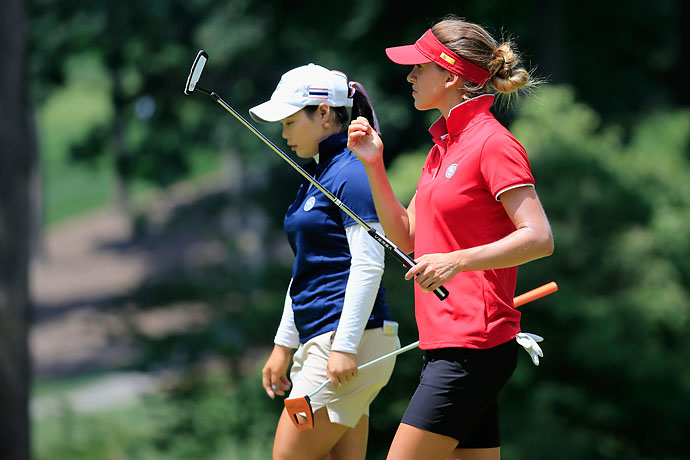 Belen Mozo of Spain, right, and Ariya Jutanugarn of Thailand walk off the 4th green during the final round of the International Crown at Cave Valley Golf Club on Sunday.