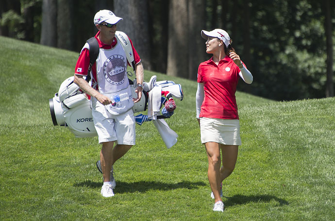 South Korean golfer So Yeon Ryu talks with her caddie during the final round of the LGPA International Crown at Caves Valley Golf Club in Owings Mills, Md.