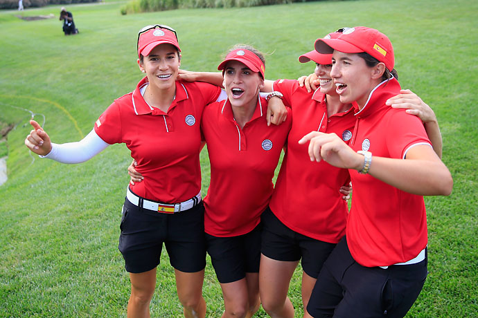 Azahara Munoz, Belen Mozo, Beatriz Recari, and Carlota Ciganda of Spain celebrate after winning the International Crown at Cave Valley Golf Club in Owings Mills, Md.