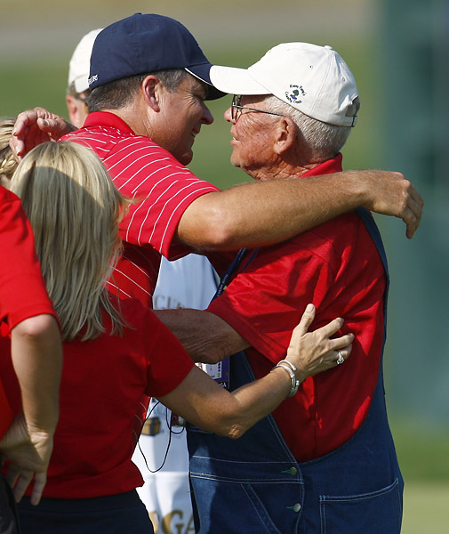 Kenny Perry hugs his father Ken Perry as he celebrates defeating Sweden's Henrik Stenson in their match during singles play in the 37th Ryder Cup Championship at the Valhalla Golf Club in Louisville, Ky.