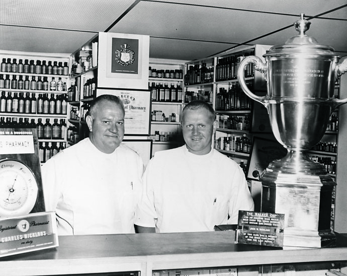 Jack at his father Charlie's pharmacy in 1960.