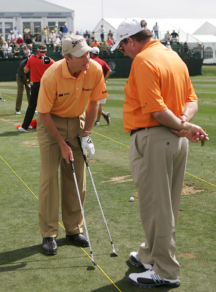 Jim Furyk talks with his father Mike about the degree off set on a new set of irons at the 2009 World Golf Championships Accenture Match Play Championship. Furyk's father has been his instructor all his life.