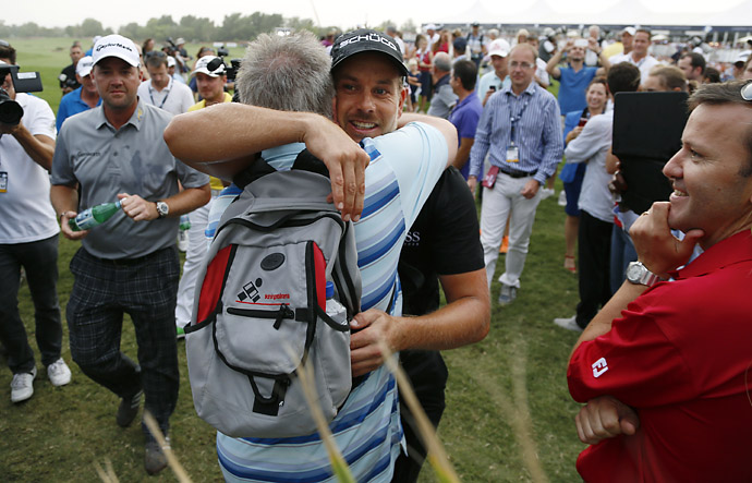 Henrik Stenson hugs his father Ingemar after winning the 2013 DP World Golf Championship, in Dubai, United Arab Emirates.