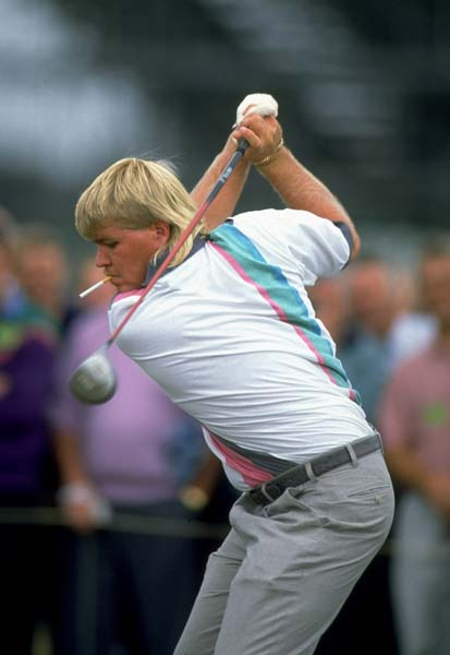 Smoke 'em if you got 'em. John Daly plays at the 1992 British Open at Muirfield after his 'Cinderella story' victory at the 1991 PGA Championship. Daly won the 1995 Open Championship at St. Andrews.