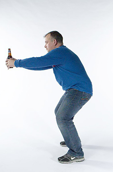 The simple, classic squat — it's so easy you can do it while holding a                     bottle of beer. Take your setup position, extend your arms, and then squat                     down as far as you can for 10 seconds. Do this three times daily, and                     gradually work up to 30 seconds per squat. Then, drink to your health!                     Benefit: Promotes better swing stability