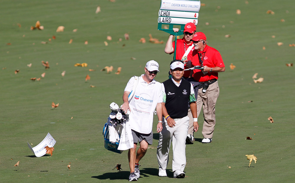 On a day that saw gusts up to 50 mph, K.J. Choi had five straight birdies to open his round. He finished in sole possession of the lead at six under.