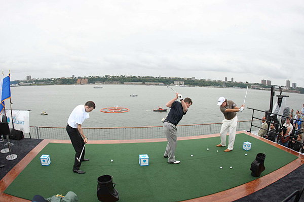 Phil Mickelson and wounded veterans hit balls into the Hudson River off the aircraft carrier Intrepid in New York City prior to the Barclays.