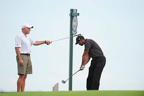Tiger Woods was photographed working on his swing with caddie Steve Williams during the practice rounds at Whistling Straits.