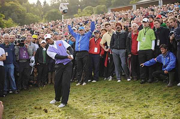 British photographer Mark Pain captured the now-famous shot that sparked the 'Cigar Guy' craze, but Sports Illustrated photographer Robert Beck snapped a similar image of Tiger Woods flubbing a chip directly at a squadron of photographers during his fourball match.