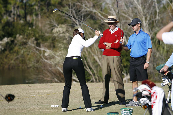 """She looked very comfortable, very composed. She hasn't played a tournament in a while, so that's a good sign,"" said her coach David Leadbetter (center). ""If she plays anywhere near her potential, this shouldn't be a problem."""