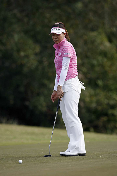 Japan's Shiho Oyama shot 71 to move one stroke ahead of Wie at 11 under par.