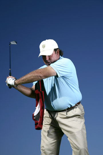 DON'T DO THIS!                   If your left arm separates from your chest in the backswing, the club is too far behind you.