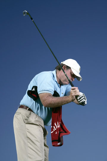 If your left elbow flies out in your downswing, the shaft is too far in front of you.
