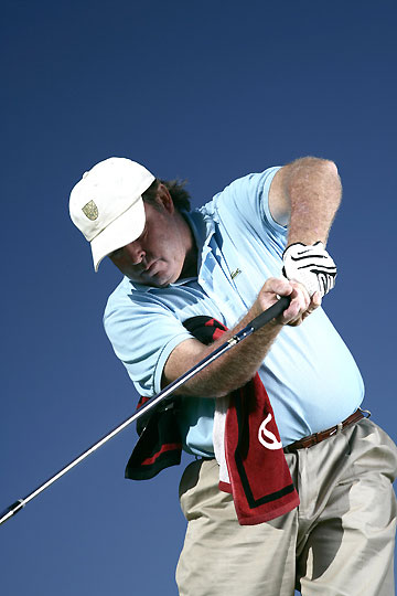 "If your left elbow comes out through impact (also known as ""chicken-winging""), hello slice!"