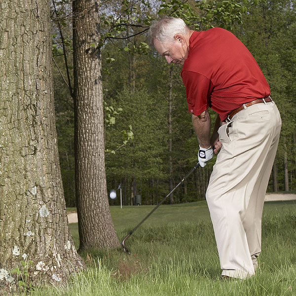 NOTE                     The last thing you want to do with this shot is use a lot of wrist action. That increases your chances of bottoming out too early or too late. Lock your wrists and make a smooth, left-handed putting stroke.