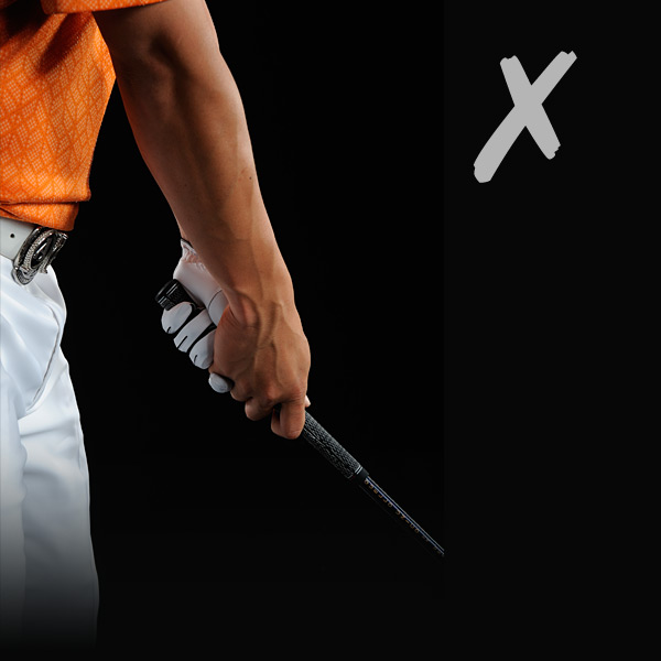 NORMAL GRIP: Gripping at the end of the handle works, but today's clubs are long enough that you don't have to.