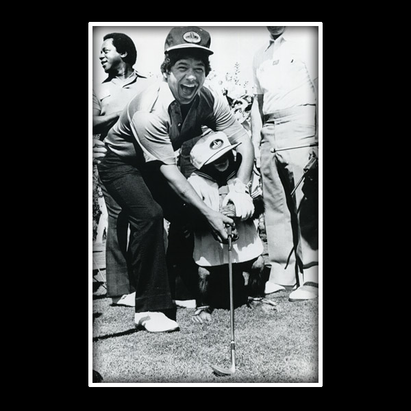 This is at the Sammy Davis Jr. tournament, the pro-am. This was a very smart chimpanzee. You could put its hands on the club. There's Flip Wilson [the comedian] in the background.                       I was on the first tee and all of a sudden this chimpanzee walks out, and he's got this golf club and the hat on. It actually scared the hell out of me for a second.