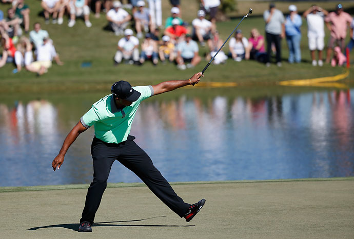 Tiger Woods makes birdie on the 15th hole during the third round of the World Golf Championships-Cadillac Championship at Trump National Doral on Saturday.