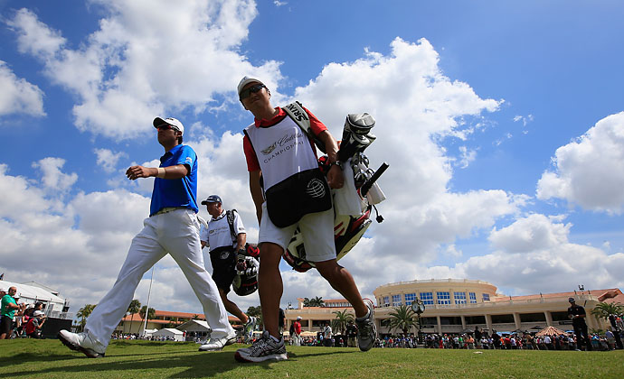 Hideki Matsuyama walks with his caddie off the first tee during the final round of the World Golf Championships-Cadillac Championship at Trump National Doral on Sunday.