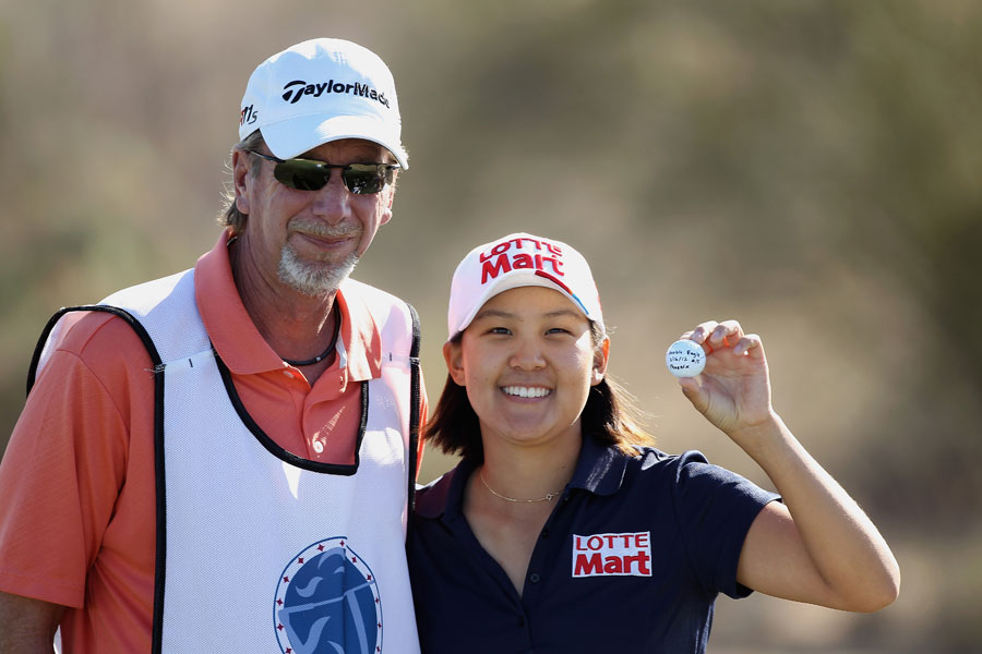 Hannah Yun celebrated with her caddie, Greg Sheridan, after making a double eagle on the par-5 15th hole.