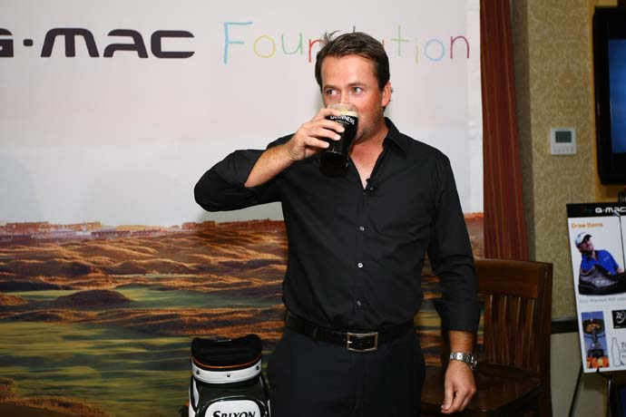 Do you drink alcohol with dinner the night before a tournament round?                        Yes: 49%                       No: 51%                        Photo: Graeme McDowell enjoys a pint of Guinness.