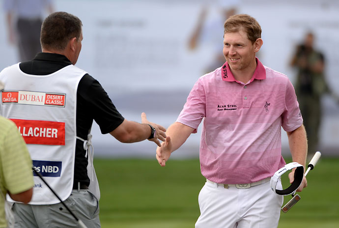 Stephen Gallacher shakes caddie's hand after shooting 63 in the third round of the Omega Dubai Desert Classic