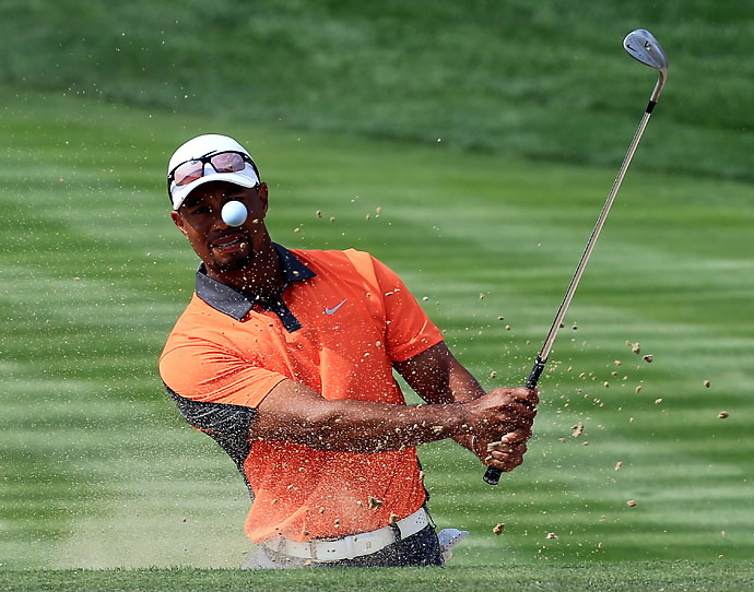 Tiger Woods hits a bunker shot on the 3rd hole during the third round of the Dubai Desert Classic