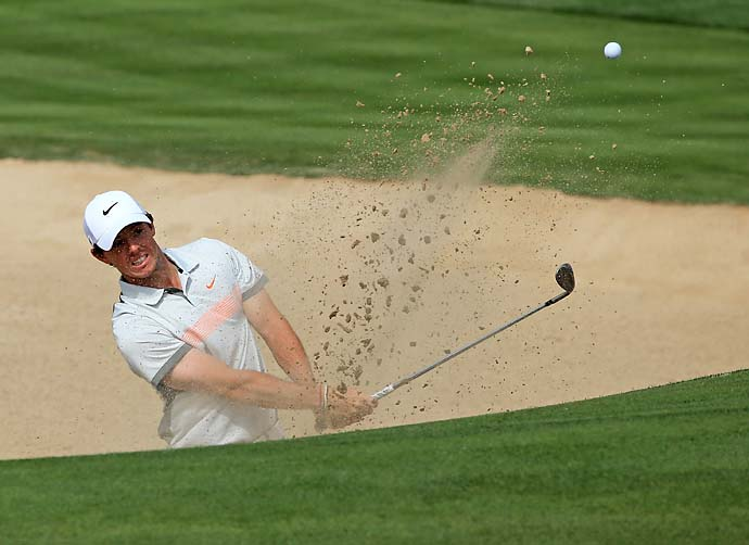 Rory McIlroy plays a bunker shot on the third hole during the second round of the 2014 Omega Dubai Desert Classic.