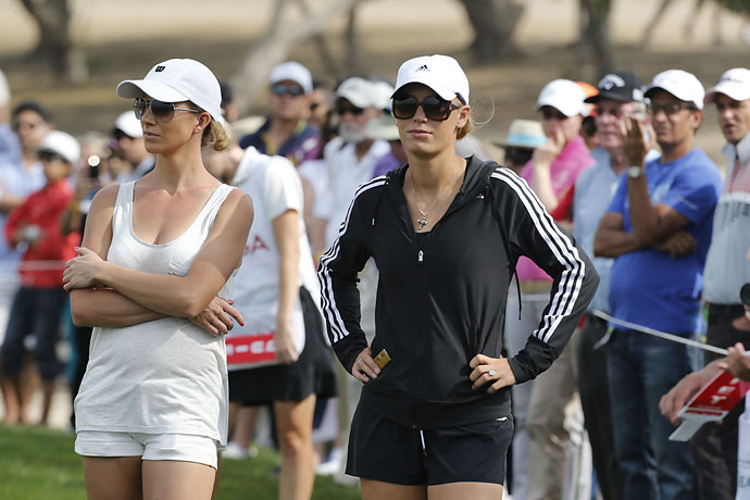 Rory McIlroy's fiancee Caroline Wozniacki and an unidentified friend attend the third round of the 2014 Omega Dubai Desert Classic.