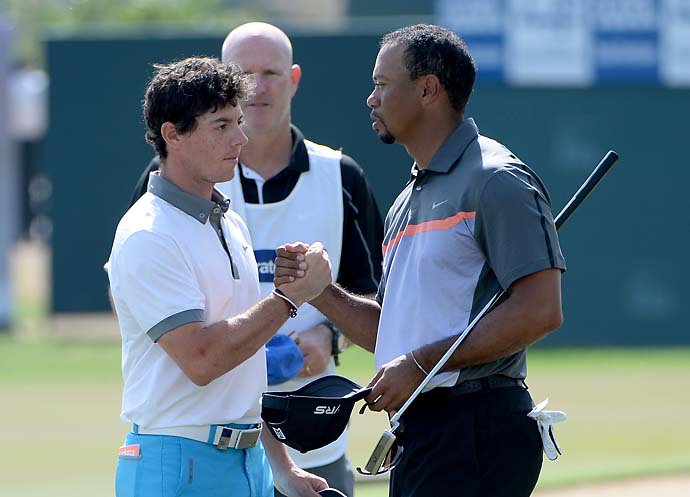 Rory McIlroy and Tiger Woods shake hands after the first round of the Omega Dubai Desert Classic on the Majlis course at the Emirates Golf Club on January 30, 2014 in Dubai, United Arab Emirates.