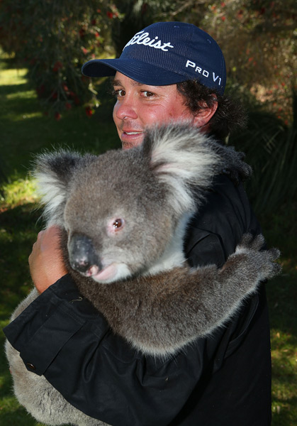 After his round Dufner cuddled with a koala bear.
