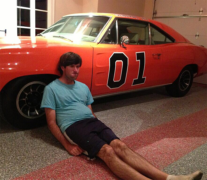 "Bubba Watson the  tweeted a photo of himself Dufnering with his car t""he General Lee: ""Hey @Keegan_Bradley just #Dufnering in the garage!!"""