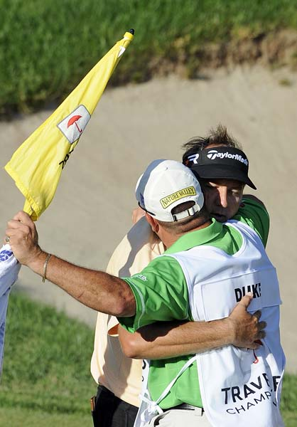 Ken Duke hugs his caddie after winning the Travelers Championship on the second playoff hole over Chris Stroud. It was the sixth playoff on Tour this season and first since Derek Ernst won the Wells Fargo Championship.