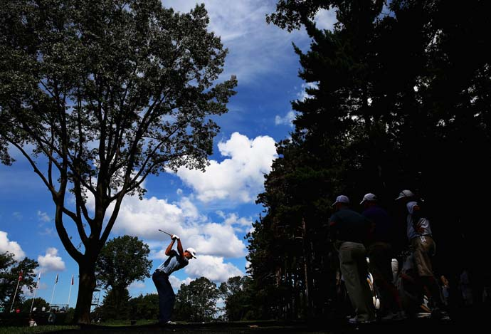 Cool shot of Dustin Johnson during his Monday practice round at Oak Hill.