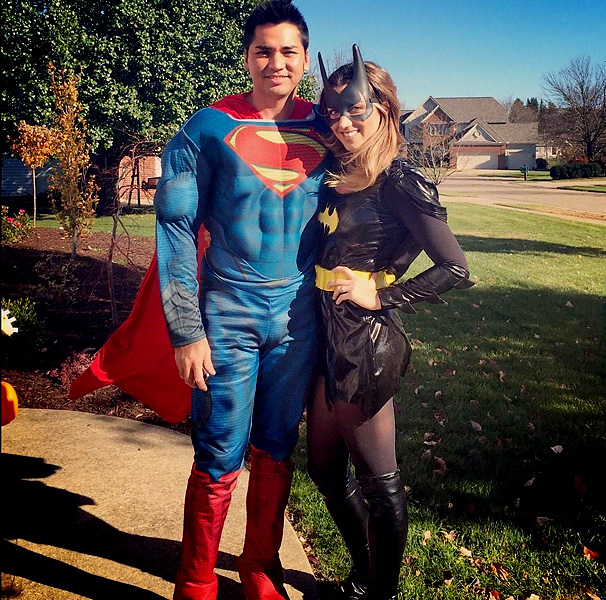 Jason Day and Ellie Day as Superman and Batman.