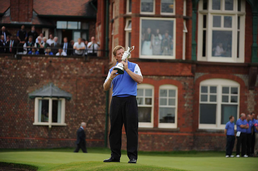 A Claret Jug and Thou                       The blue zip vest, white shirt, and black pants from the opening round were repeated on Sunday, when he became the second consecutive major winner to secure his victory in the clubhouse.                       Take a look at the style of the British Open over the years here.