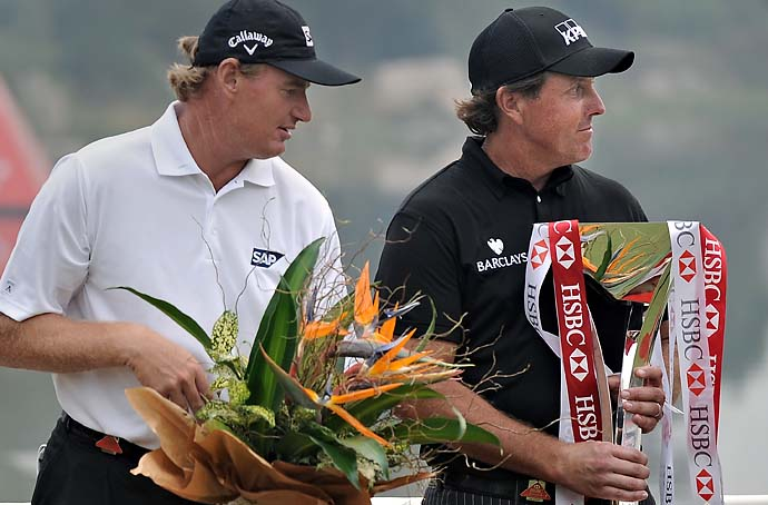 Ernie Els looks longingly at Phil Mickelson's trophy after Mickelson held off a resurgent Els in a thrilling finale to win both the WGC-HSBC Champions in Shanghai in 2009.