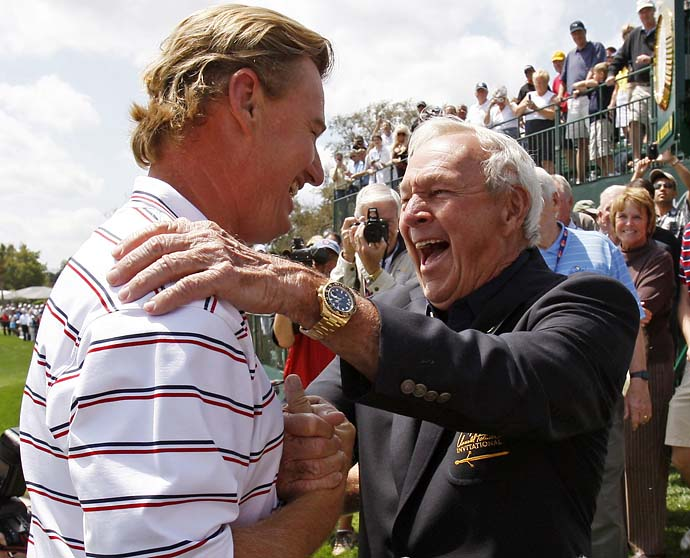 Ernie Els is congratulated by host Arnold Palmer after winning the rain delayed Arnold Palmer Invitational golf tournament  in Orlando on March 29, 2010.