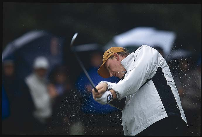 Ernie Els drives in the rain during third round at the 2002 British Open at Muirfield, generally considered the worst weather major day ever.