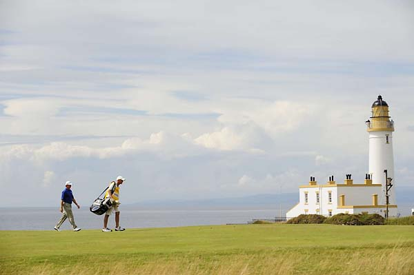 Ernie Els walks with his caddie on 9th fairway during the 2009 British Open at Turnberry.